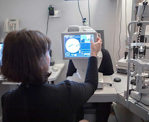 Optometrist performing examination for complex eye prescription at our London practice