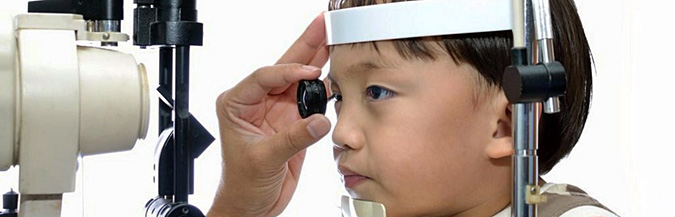 Child with myopia being examined in myopia control consultation